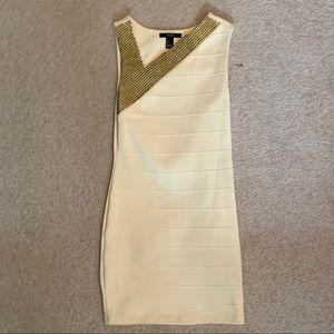 Gold studded body con dress